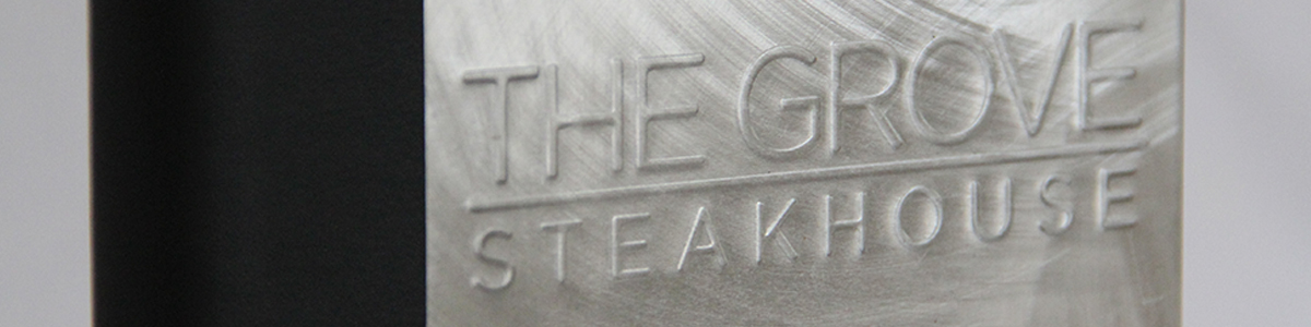 Example of embossed logo on an aluminum menu cover.